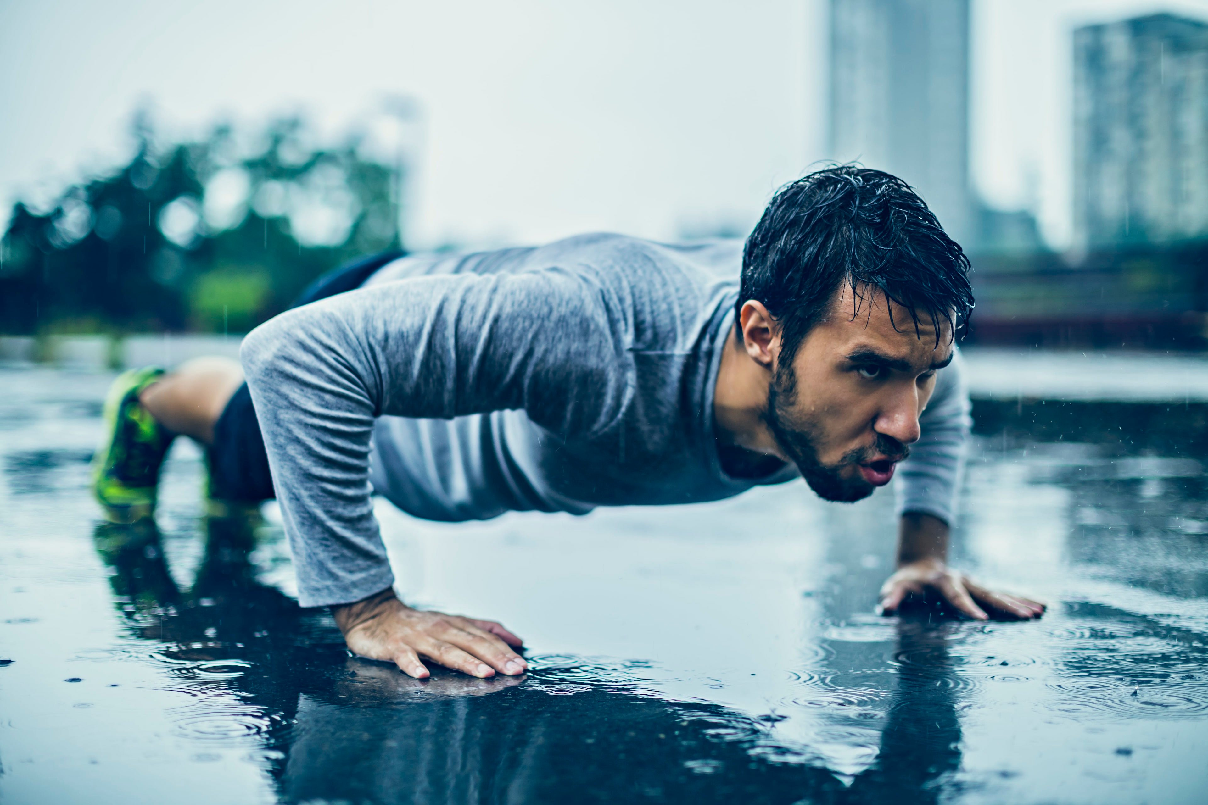 Man exercising in the rain