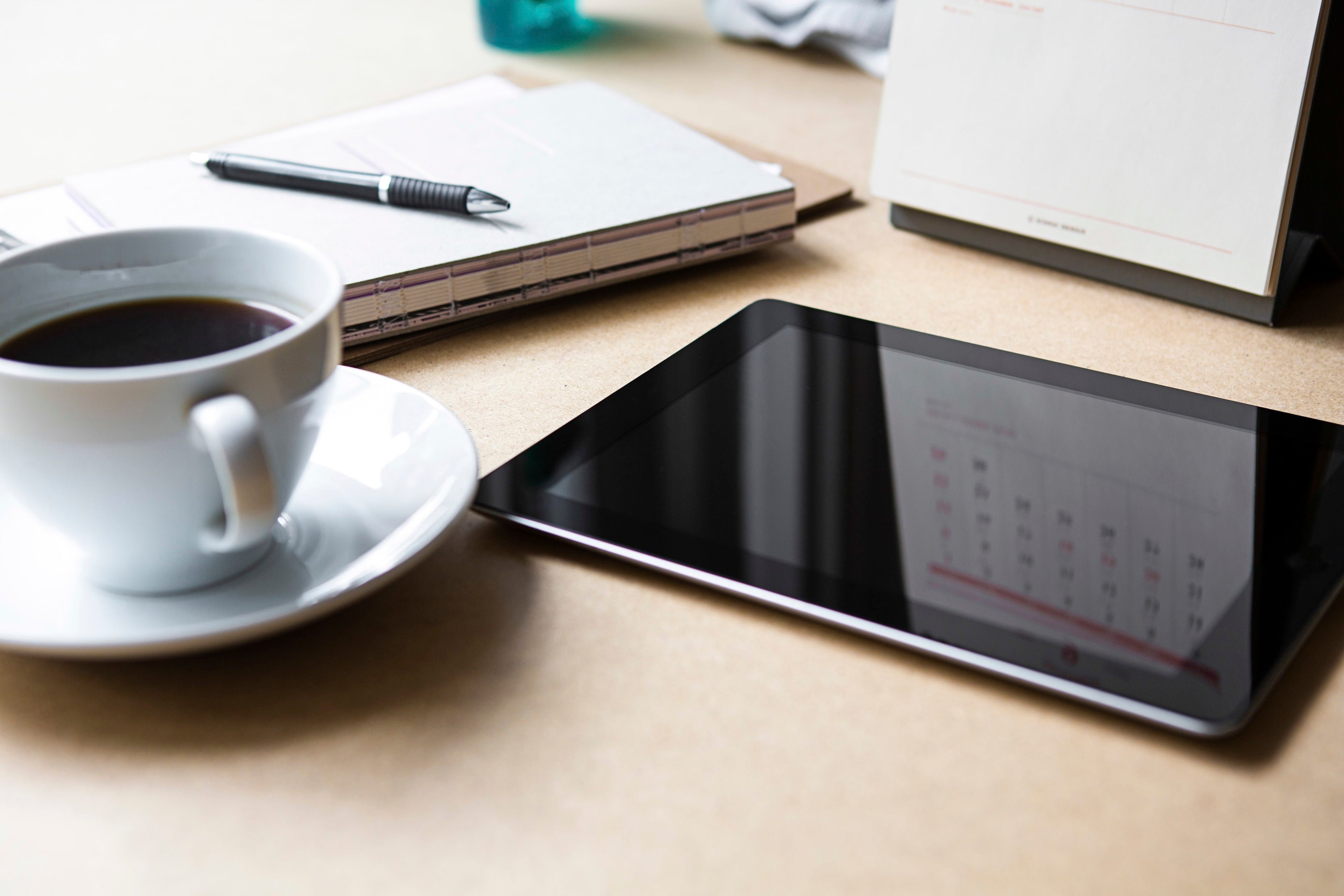 Tablet with book and coffee